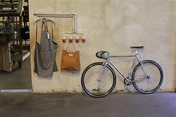 Can the apron surpass the fixie bike as the ultimate status symbol of the urban consumer?